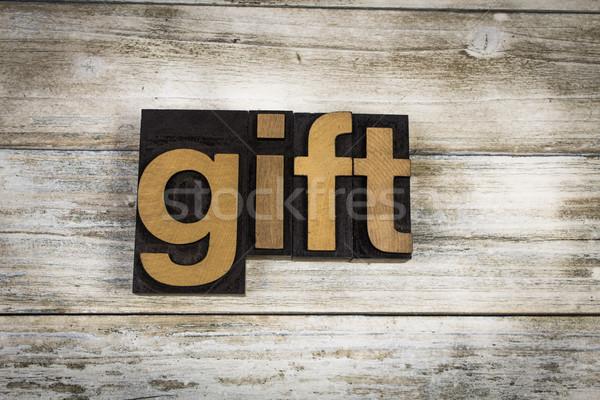 Gift Letterpress Word on Wooden Background Stock photo © enterlinedesign