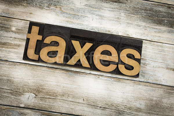 Taxes Letterpress Word on Wooden Background Stock photo © enterlinedesign