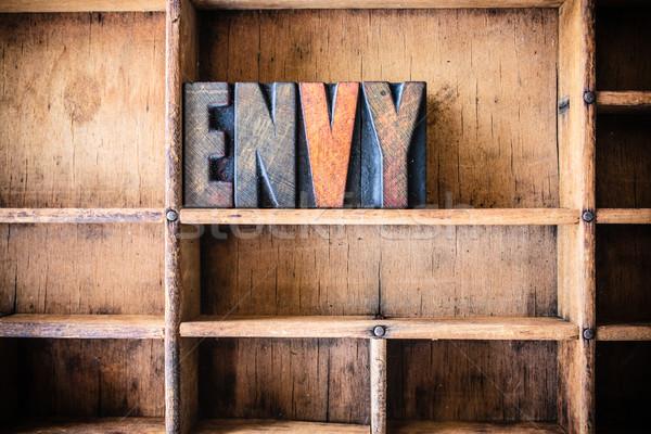 Invidiare legno parola scritto vintage Foto d'archivio © enterlinedesign