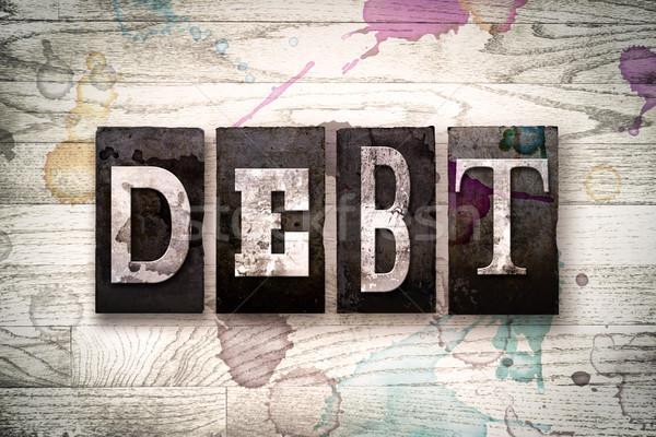 Debt Concept Metal Letterpress Type Stock photo © enterlinedesign