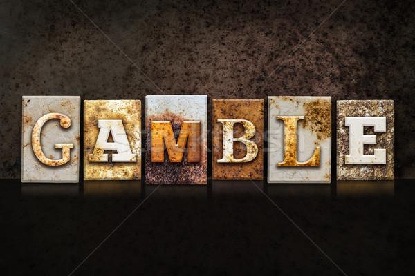 Gamble Letterpress Concept on Dark Background Stock photo © enterlinedesign