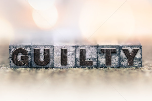 Guilty Concept Vintage Letterpress Type Stock photo © enterlinedesign