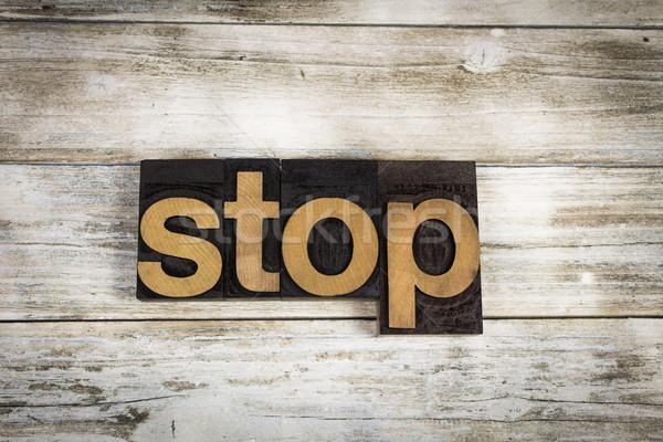 Stop Letterpress Word on Wooden Background Stock photo © enterlinedesign