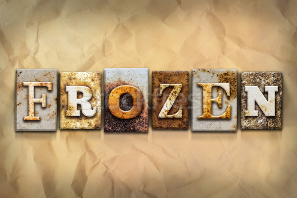 Frozen Concept Rusted Metal Type Stock photo © enterlinedesign
