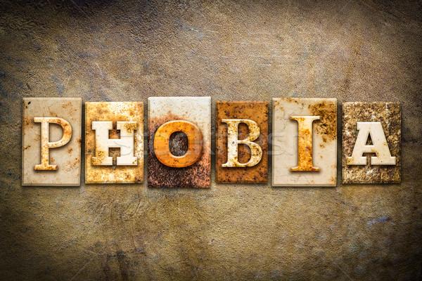 Phobie cuir mot écrit rouillée Photo stock © enterlinedesign