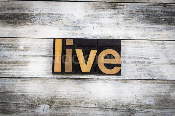 Live Letterpress Word on Wooden Background Stock photo © enterlinedesign
