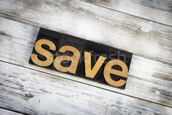 Save Letterpress Word on Wooden Background Stock photo © enterlinedesign