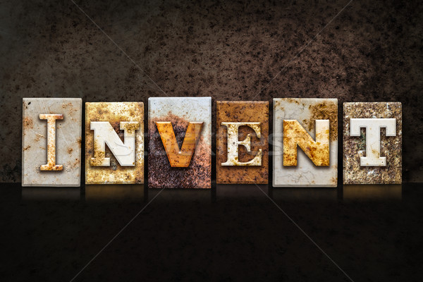 Invent Letterpress Concept on Dark Background Stock photo © enterlinedesign