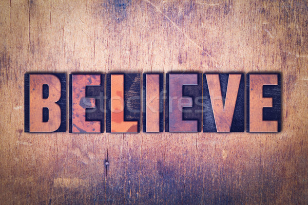 Believe Theme Letterpress Word on Wood Background Stock photo © enterlinedesign