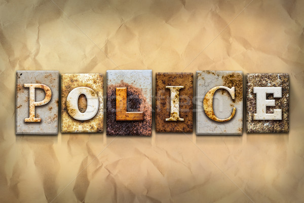 Police Concept Rusted Metal Type Stock photo © enterlinedesign