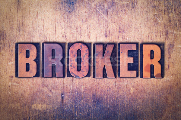 Broker Theme Letterpress Word on Wood Background Stock photo © enterlinedesign