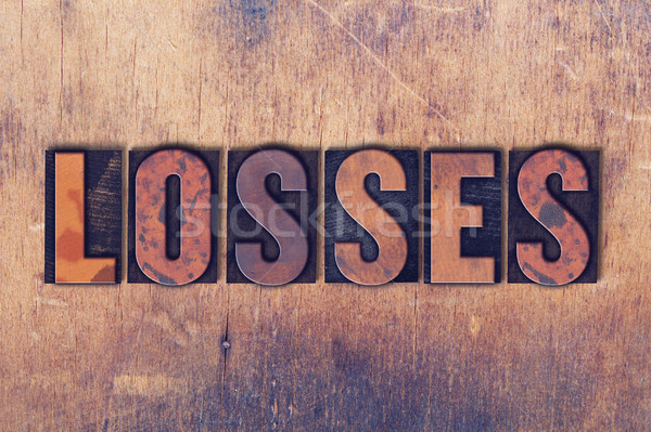 Losses Theme Letterpress Word on Wood Background Stock photo © enterlinedesign