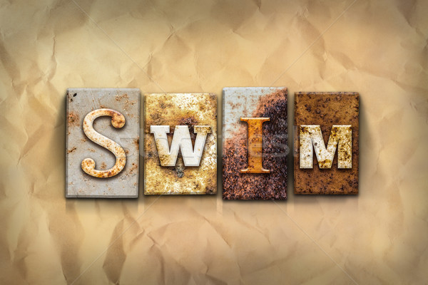 Swim Concept Rusted Metal Type Stock photo © enterlinedesign