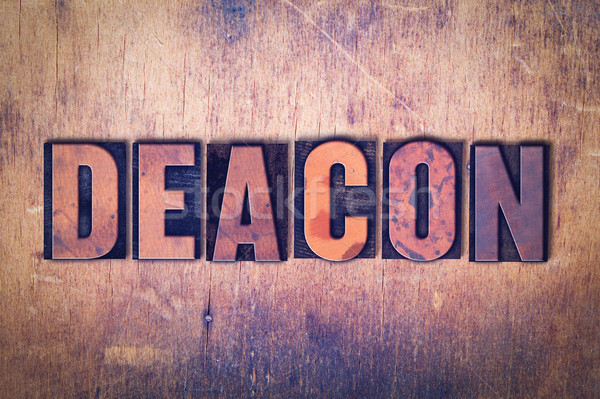 Deacon Theme Letterpress Word on Wood Background Stock photo © enterlinedesign