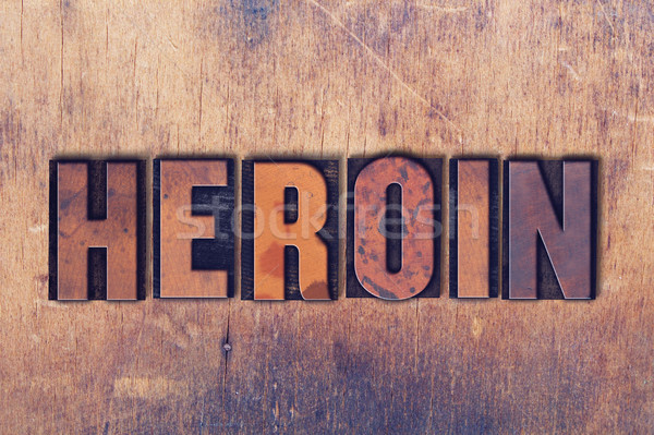 Heroin Theme Letterpress Word on Wood Background Stock photo © enterlinedesign