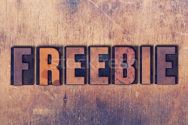 Freebie Theme Letterpress Word on Wood Background Stock photo © enterlinedesign