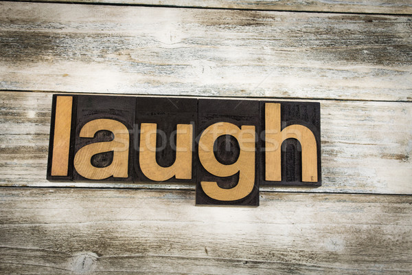 Laugh Letterpress Word on Wooden Background Stock photo © enterlinedesign