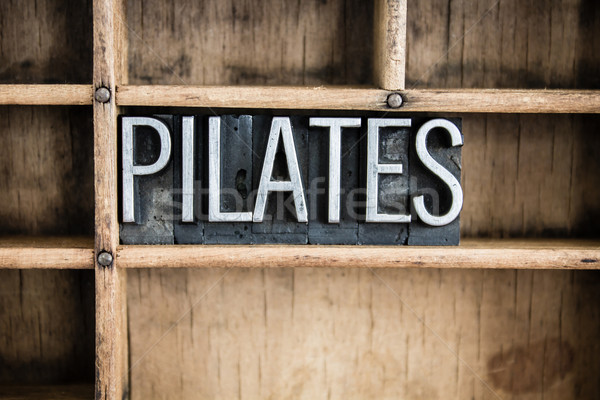 Pilates métal mot tiroir écrit Photo stock © enterlinedesign
