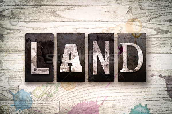 Land Concept Metal Letterpress Type Stock photo © enterlinedesign
