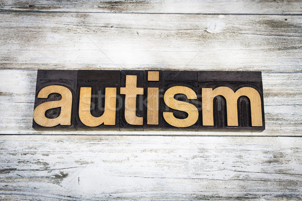 Autism Letterpress Word on Wooden Background Stock photo © enterlinedesign