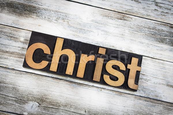 Christ Letterpress Word on Wooden Background Stock photo © enterlinedesign