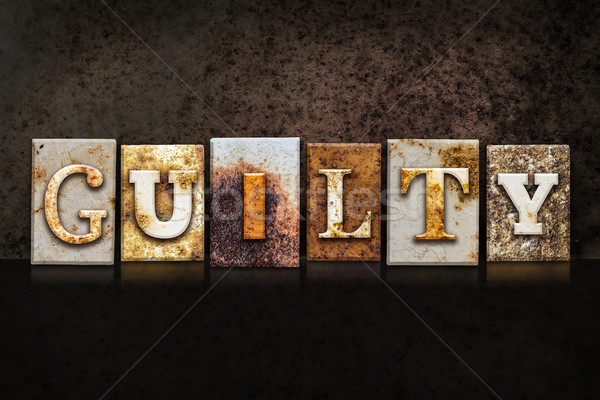 Guilty Letterpress Concept on Dark Background Stock photo © enterlinedesign