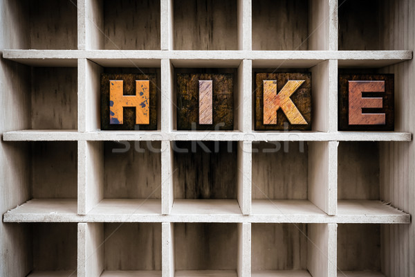 Hike Concept Wooden Letterpress Type in Draw Stock photo © enterlinedesign