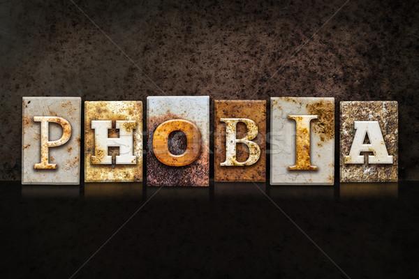 Phobie sombre mot écrit rouillée Photo stock © enterlinedesign