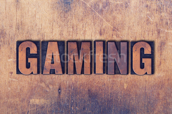 Gaming Theme Letterpress Word on Wood Background Stock photo © enterlinedesign