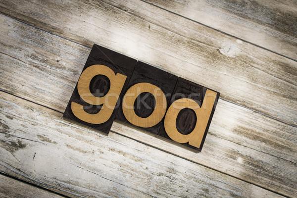 God Letterpress Word on Wooden Background Stock photo © enterlinedesign
