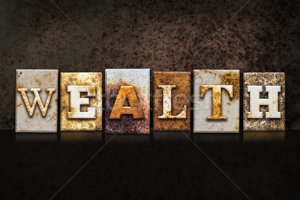 Wealth Letterpress Concept on Dark Background Stock photo © enterlinedesign