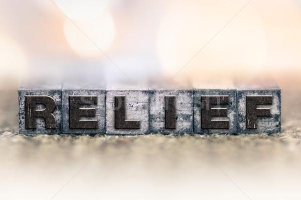 Alivio vintage tipo palabra escrito Foto stock © enterlinedesign