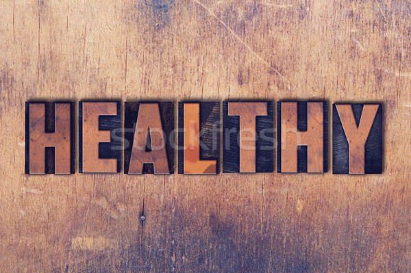 Healthy Theme Letterpress Word on Wood Background Stock photo © enterlinedesign