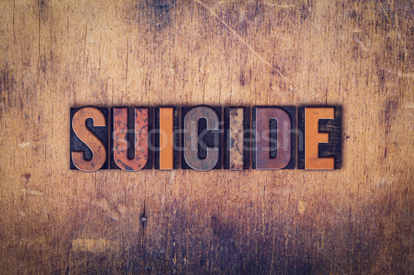 Suicide bois type mot écrit Photo stock © enterlinedesign