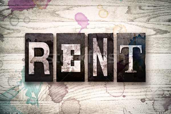 Rent Concept Metal Letterpress Type Stock photo © enterlinedesign