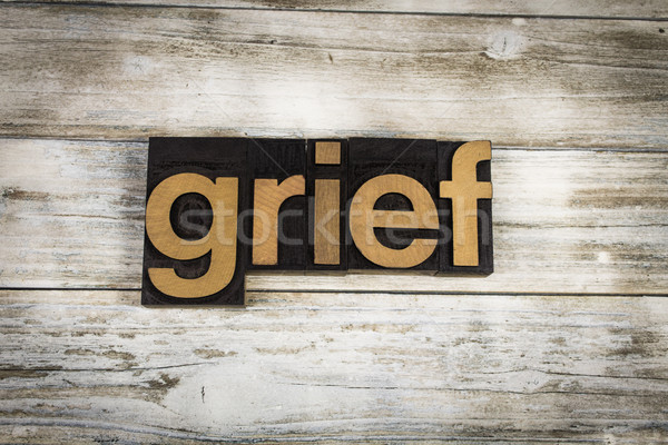 Grief Letterpress Word on Wooden Background Stock photo © enterlinedesign