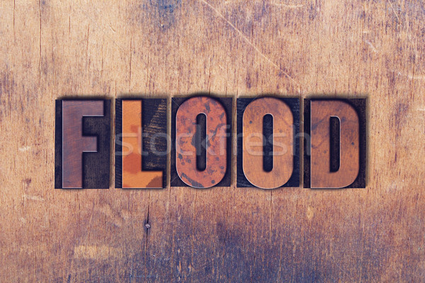 Flood Theme Letterpress Word on Wood Background Stock photo © enterlinedesign