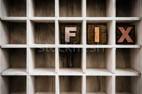 Fix Concept Wooden Letterpress Type in Draw Stock photo © enterlinedesign