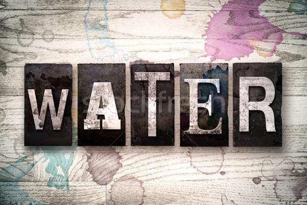 Water Concept Metal Letterpress Type Stock photo © enterlinedesign