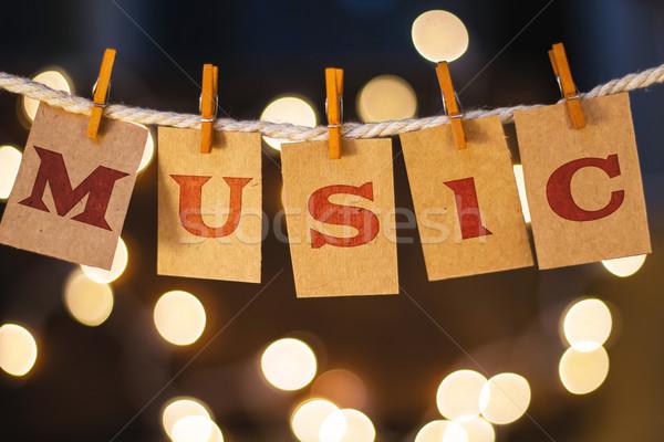 Musique cartes lumières mot imprimé pince à linge Photo stock © enterlinedesign