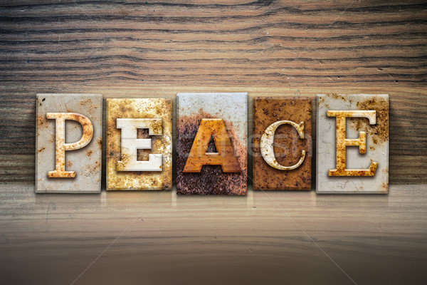 Pace parola scritto arrugginito metal Foto d'archivio © enterlinedesign