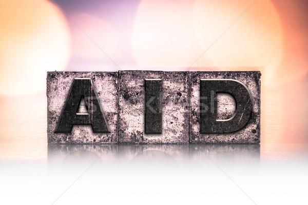 Aid Concept Vintage Letterpress Type Stock photo © enterlinedesign