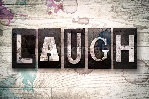 Laugh Concept Metal Letterpress Type Stock photo © enterlinedesign