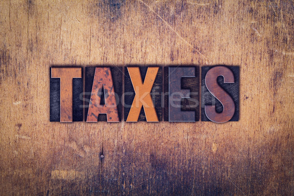 Taxes Concept Wooden Letterpress Type Stock photo © enterlinedesign