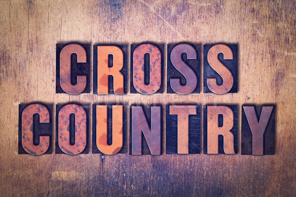 Cross Country Theme Letterpress Word on Wood Background Stock photo © enterlinedesign