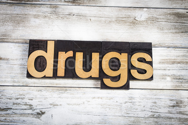 Drugs Letterpress Word on Wooden Background Stock photo © enterlinedesign
