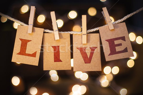Live Concept Clipped Cards and Lights Stock photo © enterlinedesign