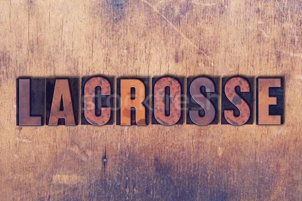 Lacrosse Theme Letterpress Word on Wood Background Stock photo © enterlinedesign