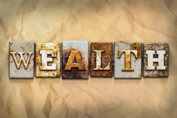 Wealth Concept Rusted Metal Type Stock photo © enterlinedesign