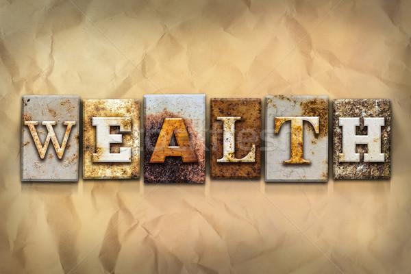 Reichtum verrostet Metall Typ Wort geschrieben Stock foto © enterlinedesign